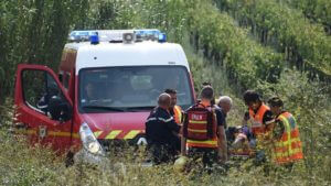 Rescuers carry an injured person on a stretcher to a waiting ambulance on August 17, 2017,  following a train crash near the French city of Montpellier. A regional train crashed into a tree which had fallen on to the tracks in southern France leaving around 10 people with serious injuries, rescue workers said. The train was travelling at 140 kilometres an hour (87 mph) between Nimes and Montpellier when it hit a tree that had been uprooted by a hailstorm, they said.  / AFP / SYLVAIN THOMAS        (Photo credit should read SYLVAIN THOMAS/AFP/Getty Images)