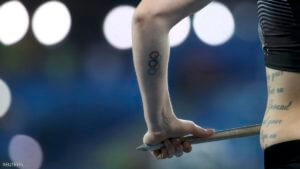 2016 Rio Olympics - Athletics - Preliminary - Women's Javelin Throw Qualifying Round - Groups - Olympic Stadium - Rio de Janeiro, Brazil - 16/08/2016. A tattoo of the Olympic Rings is seen on the forearm of Liz Gleadle (CAN) of Canada. REUTERS/Alessandro Bianchi FOR EDITORIAL USE ONLY. NOT FOR SALE FOR MARKETING OR ADVERTISING CAMPAIGNS.