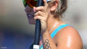 2016 Rio Olympics - Canoe Sprint - Semifinal - Women's Kayak Single (K1) 500m - Semifinal - Lagoa Stadium - Rio de Janeiro, Brazil - 17/08/2016. Naomi Flood (AUS) of Australia with Olympic rings tattoo on her arm. REUTERS/Murad Sezer FOR EDITORIAL USE ONLY. NOT FOR SALE FOR MARKETING OR ADVERTISING CAMPAIGNS.